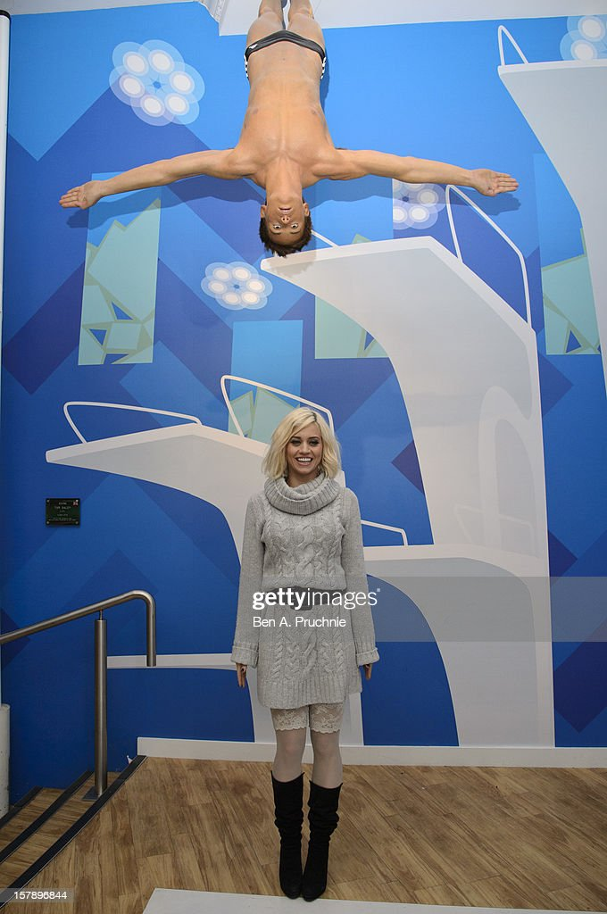 Pussycat Doll Kimberly Wyatt poses next to a wax figure of Tom Daley at Madame Tussauds on December 7, 2012 in London, England.