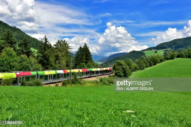 Puster valley railway train near Valdaora, Puster valley, Trentino-Alto Adige, Italy.
