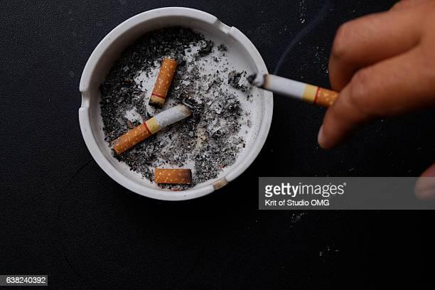 Put down the cigarette in the ashtray