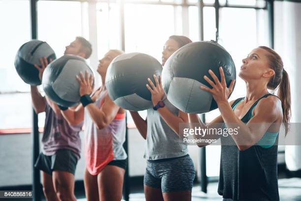 put in the work - medicine ball stock pictures, royalty-free photos & images