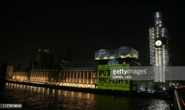 TOPSHOT A Put it to the People message is projected onto the Palace of Westminster calling for a second referendum in Westminster central London on...