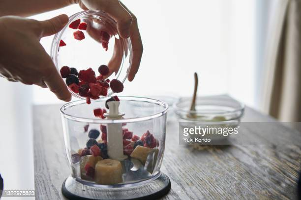 put the ingredients in the blender. - ingredient stock pictures, royalty-free photos & images