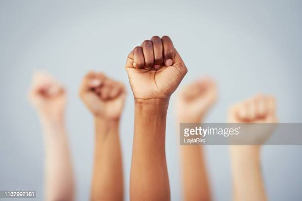 put the power back in your hands - protestor stock pictures, royalty-free photos & images