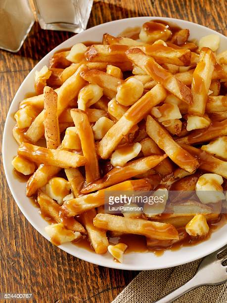 poutine - gravy stock photos and pictures