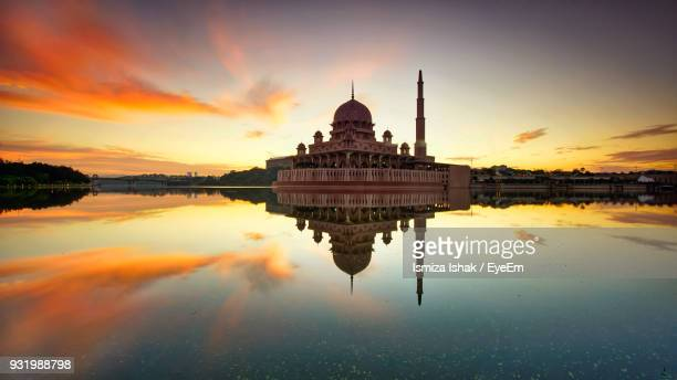 Putra Mosque In Lake Against Sky During Sunset