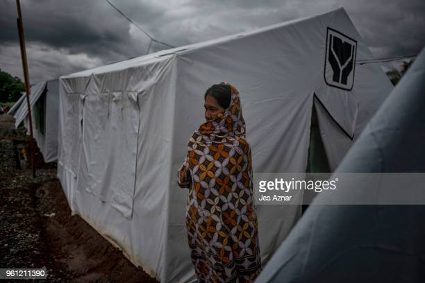 Putre Ali standing in front of their shelter inside the Sarimanok tent city on May 16 2018 in Marawi Philippines Putre is the mother of Samira Ali...