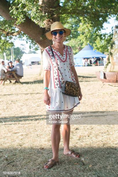 Putri McVicker wears a Mango dress and earrings Whistles bag Marc Jacobs sunglasses and Birkenstock sandals during Wilderness Festival 2018 at...
