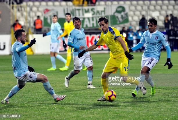 Putsila of MKE Ankaragucu in action against Emre Belozoglu and Edin Visca of Medipol Basaksehir during Turkish Super Lig match between MKE Ankaragucu...