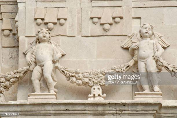 Putti on the facade of St Sebastian cathedral Acireale Sicily Italy 17th century