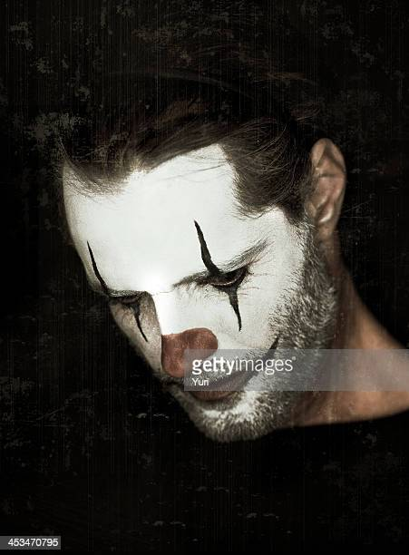 putting a sad face on - sad clown stock photos and pictures