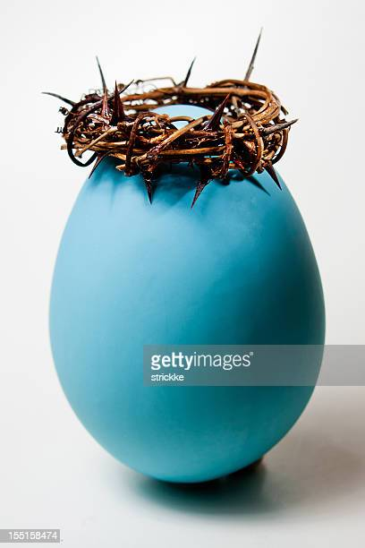 putting christ back in easter--egg with crown of thorns - death and resurrection of jesus stock photos and pictures