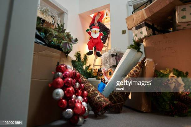 putting christmas back in the attic - humor stock pictures, royalty-free photos & images