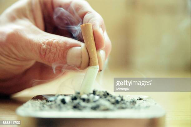 Putting cigarette stub out into ashtray 26th January 2000