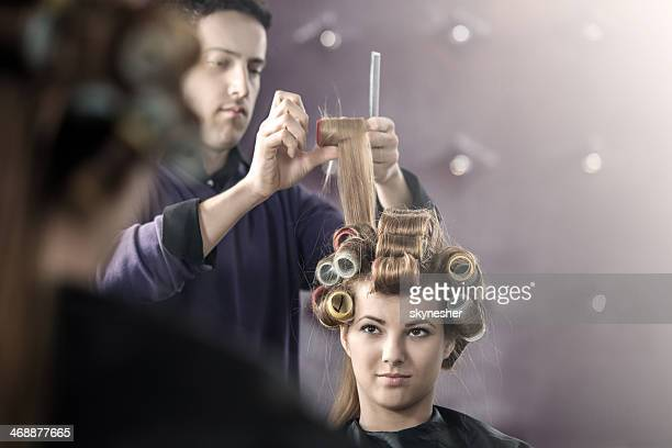 Putting curlers at the hair salon.