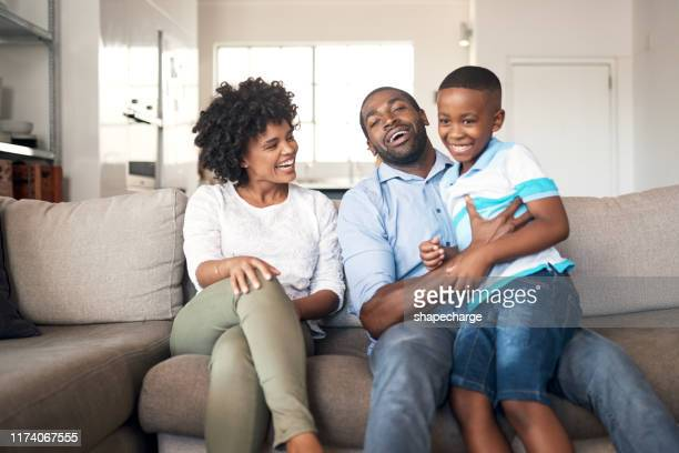 putting family time first - images of black families stock pictures, royalty-free photos & images