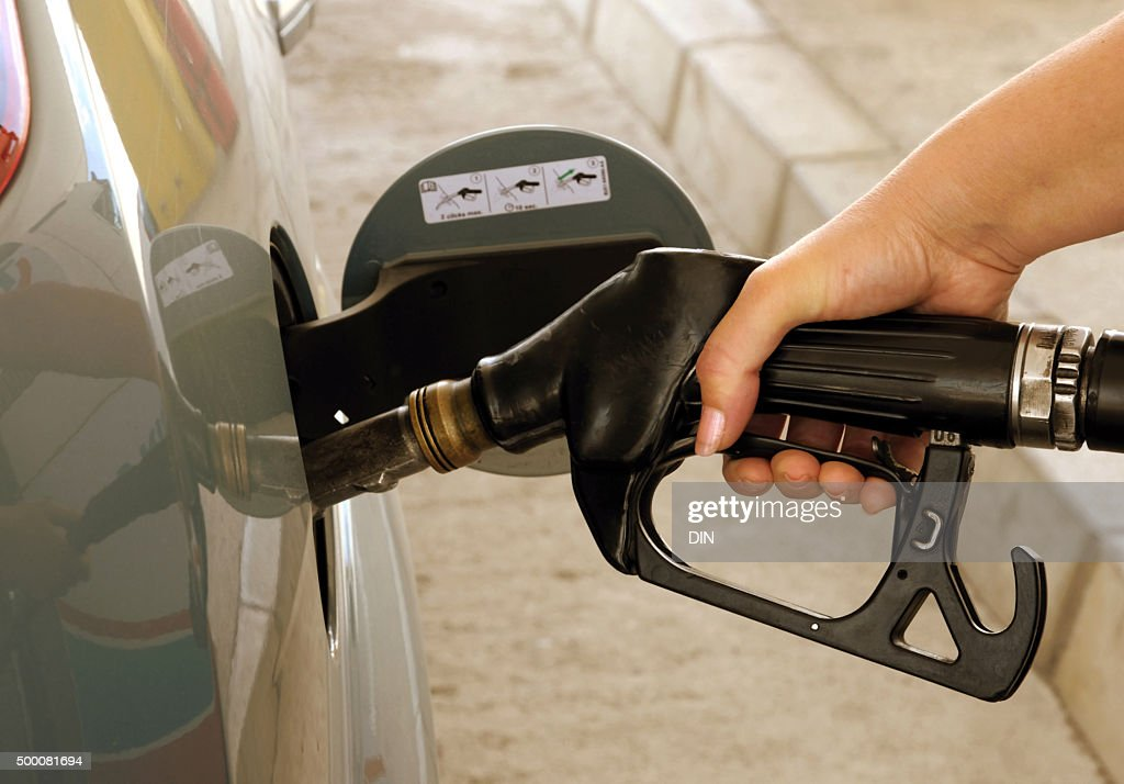 Putting gasoline in vehicle : Stock Photo