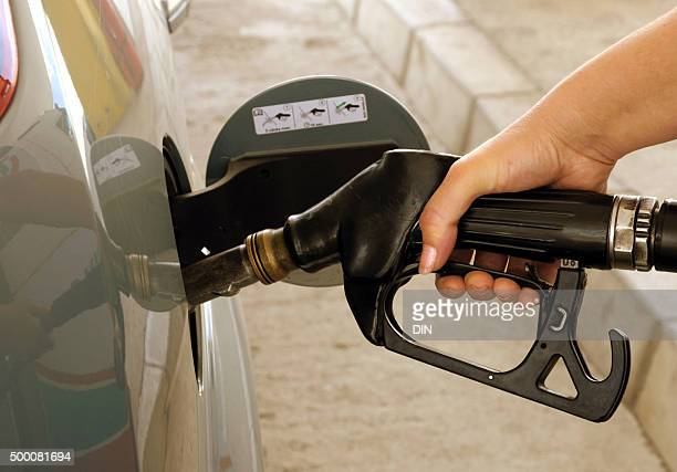 Putting gasoline in vehicle