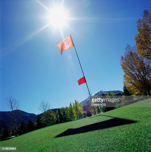Putting green and red flag
