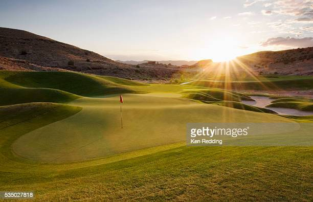 putting green at sunset - golf stock pictures, royalty-free photos & images