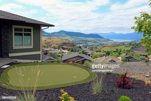 putting green in the front yard - putting green stock pictures, royalty-free photos & images