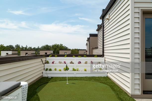 Putting Green on the Roof Terrace of the Dylan Model Townhome at Regency at Belmont on August 6, 2021 in Ashburn Virginia.
