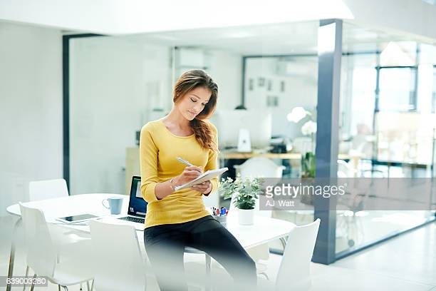 putting her ideas to paper - office supply stock photos and pictures