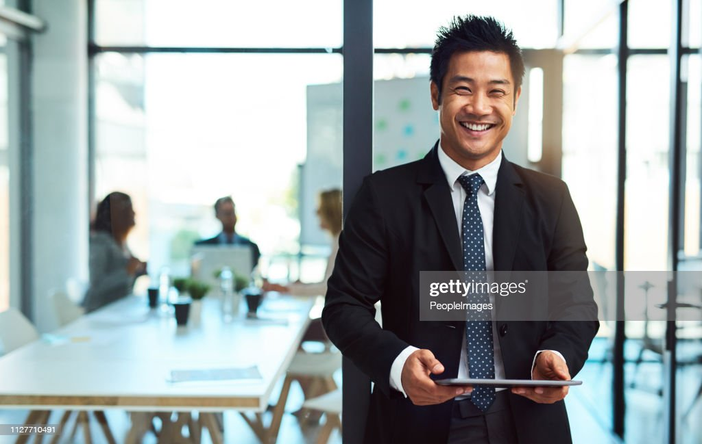 Putting his business online : Stock Photo