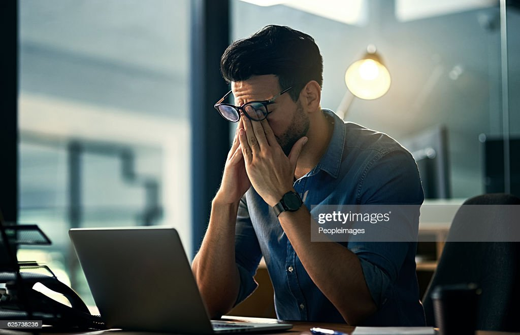 Putting his career first and his health second : Stock Photo