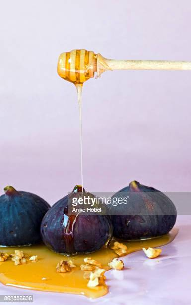 Putting honey on fig