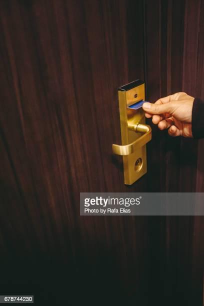 Putting hotel room key card