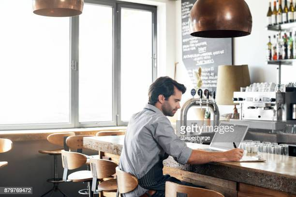 putting in the hard work - restaurant stock photos and pictures