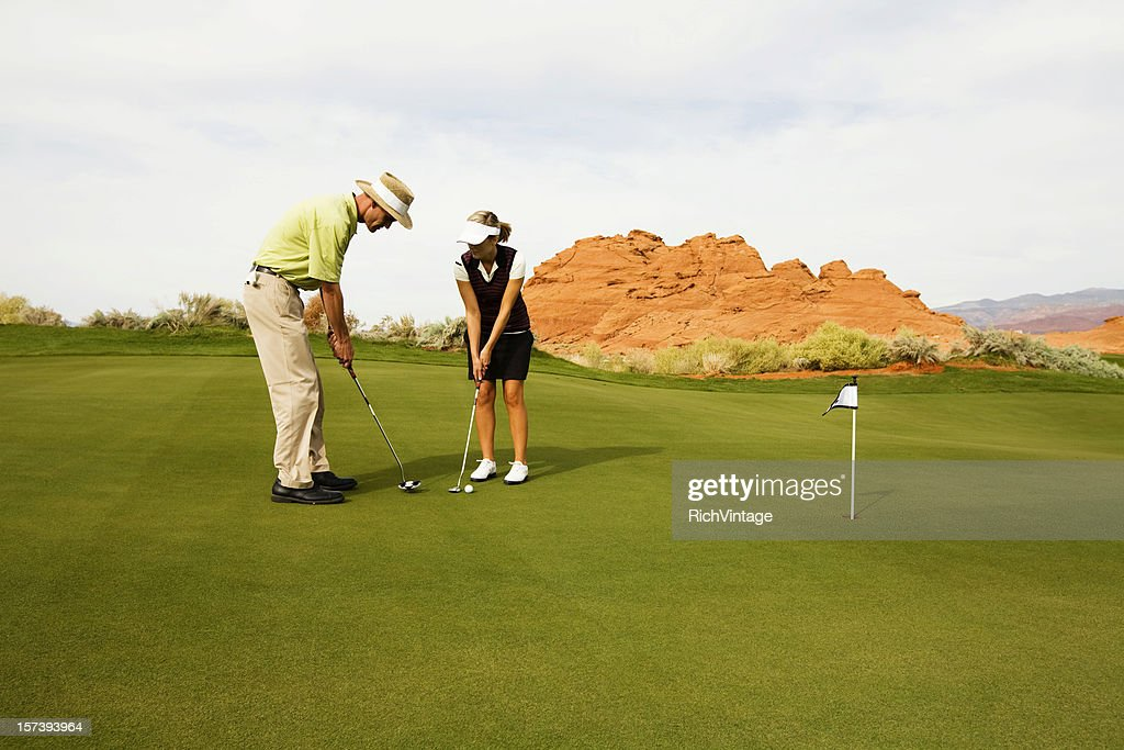 Putting Instruction Stock Photo Getty Images