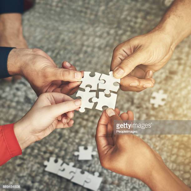putting it all together - four people stock pictures, royalty-free photos & images
