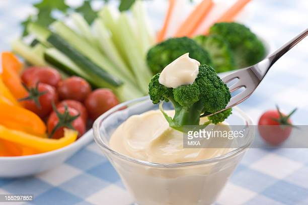 putting mayonnaise on broccoli - dipping stock photos and pictures