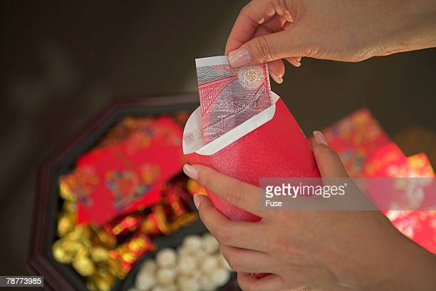 Putting Money into Red Packets