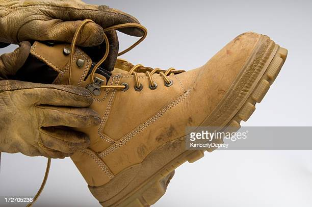 putting on a work boot