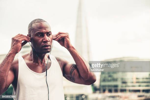 Putting on earphones for a jog