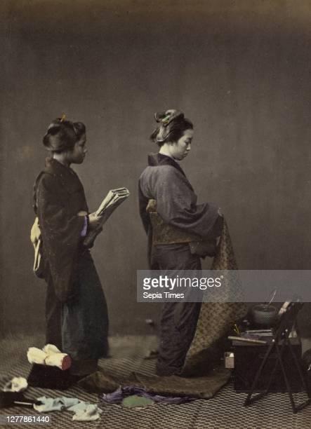 Putting on the Obi or Girdle Felice Beato Japan 1866 1867 Handcolored Albumen silver print