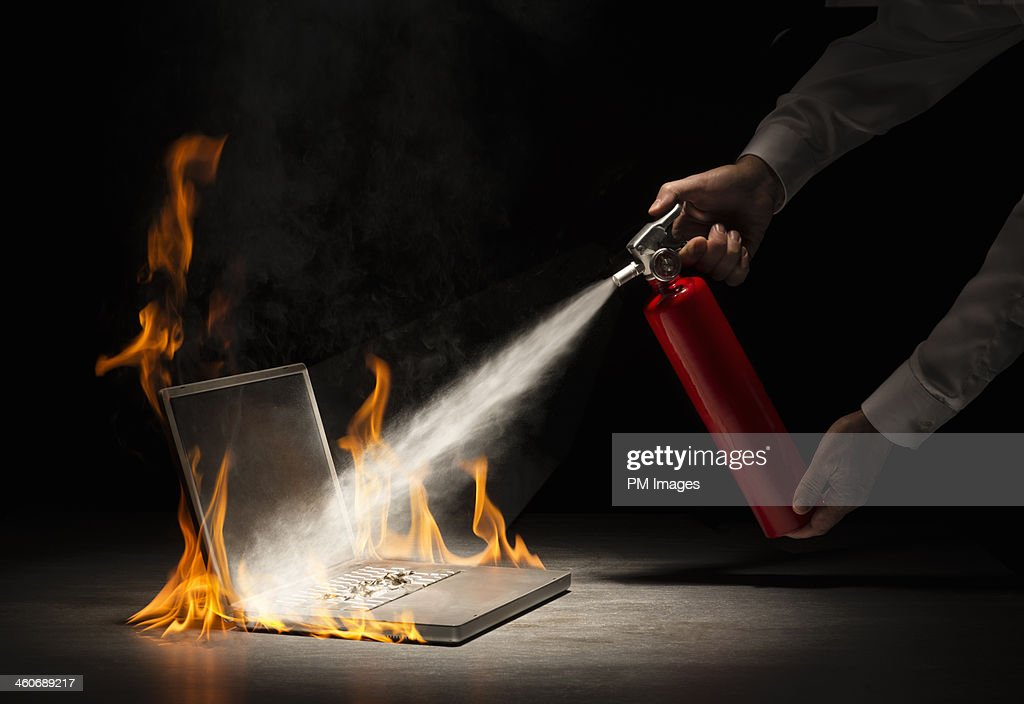 Putting out a computer fire : Stock Photo