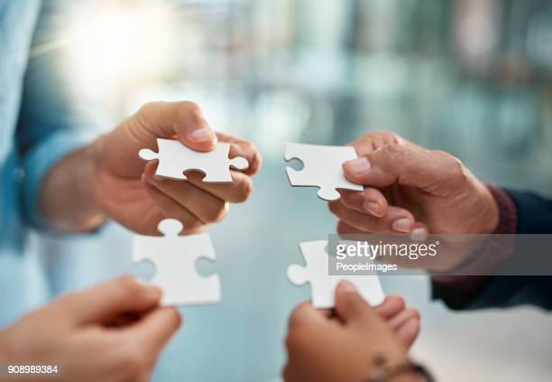 putting pieces of their plan together - jigsaw piece stock pictures, royalty-free photos & images