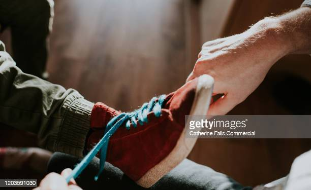 putting shoes on - tying shoelace stock pictures, royalty-free photos & images