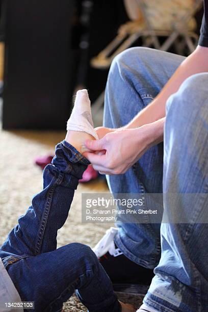 Putting socks on toddler
