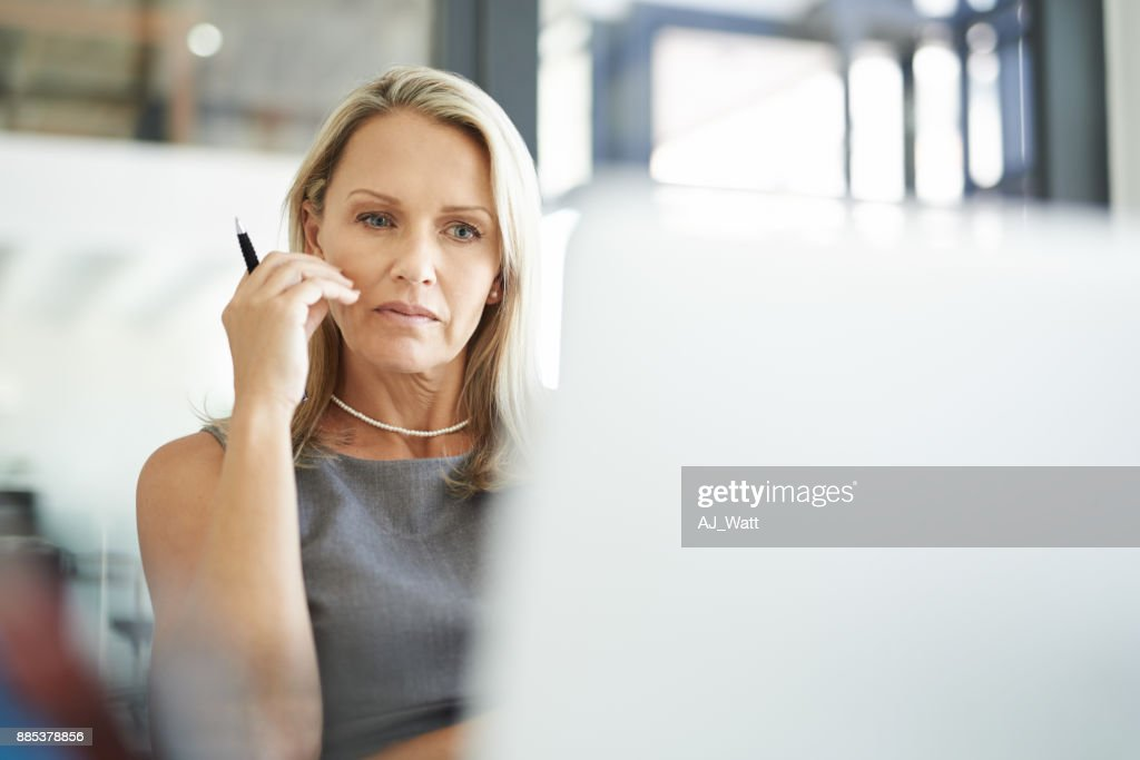 Putting some serious mind work into a work task : Stock Photo