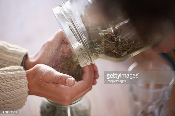 Putting tea leaves in jars
