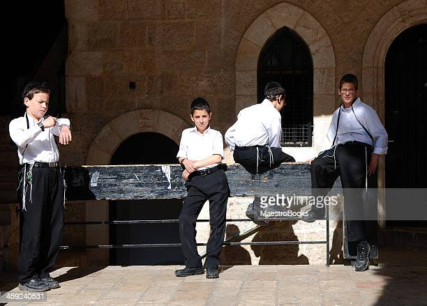 putting tefilim in the morning. - hasidic jews stock photos and pictures