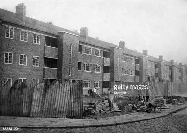 Putting the finishing touches to the new block of flats near Willert Street Police Station on Rochdale Road Manchester 11th September 1948