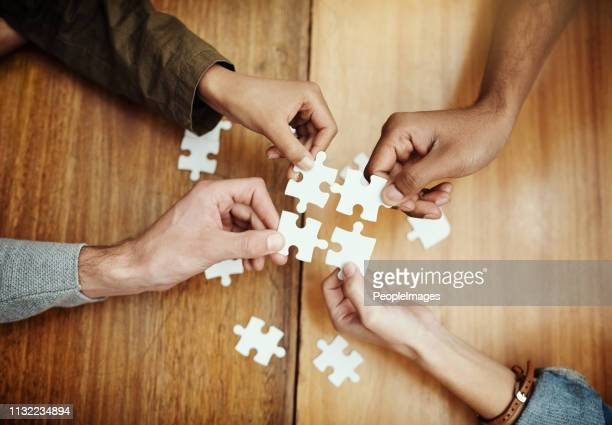 putting the pieces together - togetherness stock pictures, royalty-free photos & images