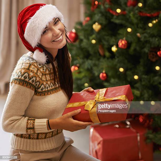 putting the presents under the tree - smiling jesus stock pictures, royalty-free photos & images