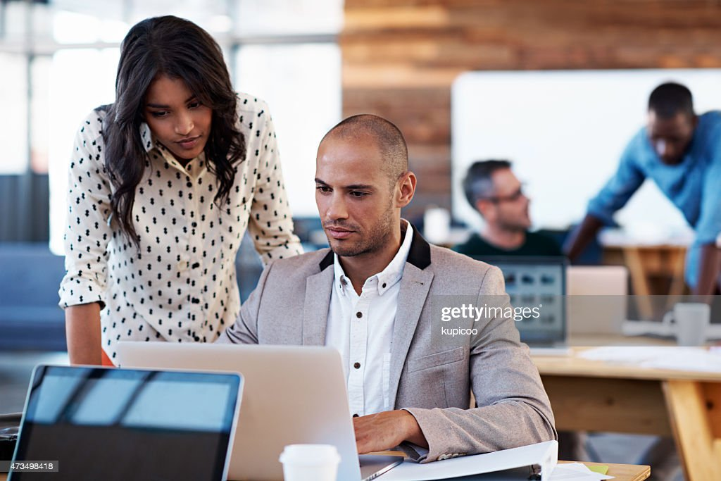 Putting their heads together on the project : Stock Photo