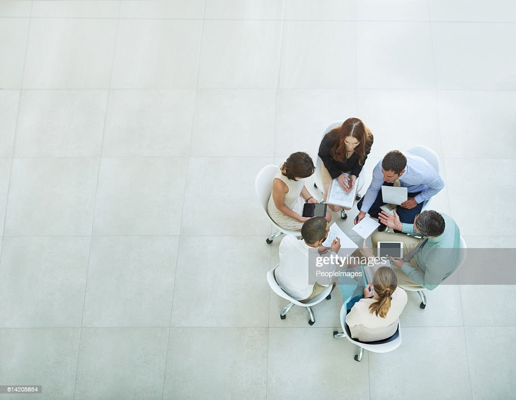 Putting their heads together : Stock Photo